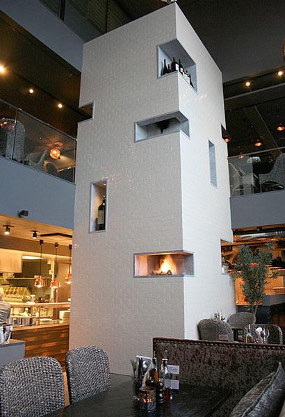 Flislagt gasspeis i restaurant på Aker Brygge i Oslo. Foto.
